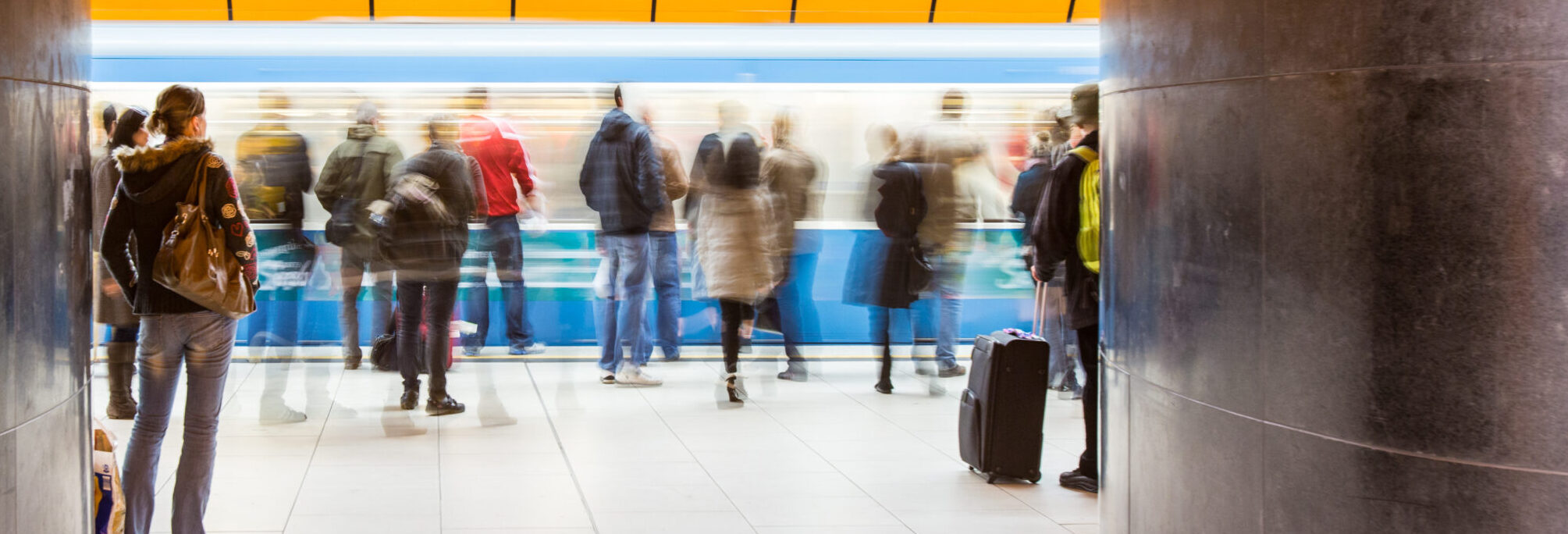 Image of blurry people on a subway platform